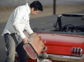 Man filling gas tank